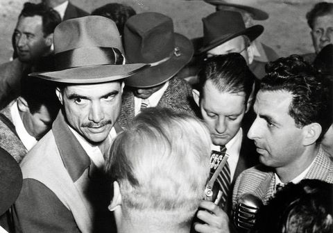 Howard Hughes Being Surrounded by Reporters